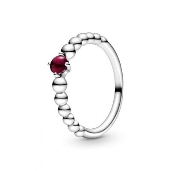 Korálikový prsteň s tmavočerveným kameňom